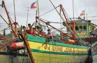 IDLE BOATS Children play on a fishing boat docked in Sitio Balogo, Barangay (village) Inhobol, Masinloc, Zambales province, which faces the West Philippine Sea. The fishermen say they have been avoiding the Scarborough Shoal due to the aggression of Chinese Coast Guard vessels. INQUIRER PHOTO/JOAN BONDOC