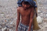 kid carrying charcoal in subic