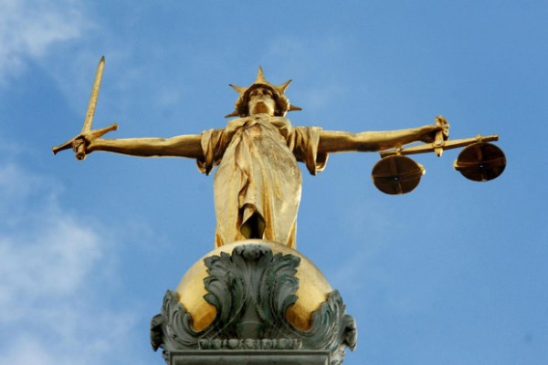 The statue on top of the Central Criminal Court, also referred to as Old Bailey, in London (Picture: PA)