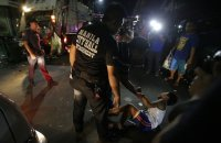 """In this Wednesday June 8, 2016 photo, a Filipino boys cries as he is apprehended by a social worker and police for violating a night to dawn curfew for minors in Manila, Philippines. In a crackdown, dubbed """"Oplan Rody,"""" bearing Duterte's name, police rounded up hundreds of children or their parents to enforce a night curfew for minors, and taken away drunk and shirtless men roaming metropolitan Manila's slums. The poor, who were among Duterte's strongest supporters, are getting a foretaste of the war against crime he has vowed to wage. AP"""
