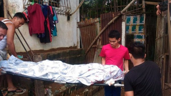 The body of drug suspect Jack Bertulfo is being taken out of his house after the Olongapo City police shot him dead when he tried to engage cops searching his house in a gunfight on Wednesday (July 13, 2016) afternoon. Photo from the Olongapo City Police Office