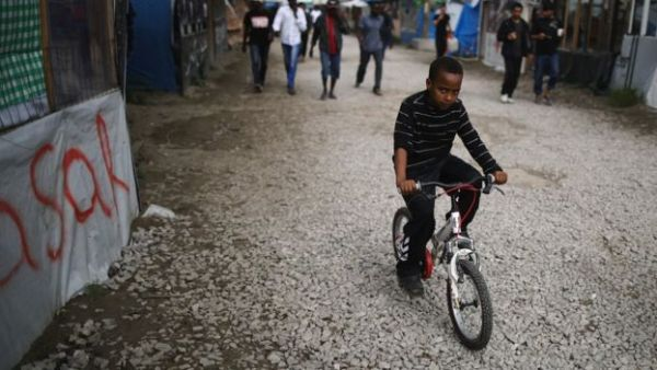 """Charities estimate there are about 1,000 unaccompanied children in the Calais """"Jungle"""""""
