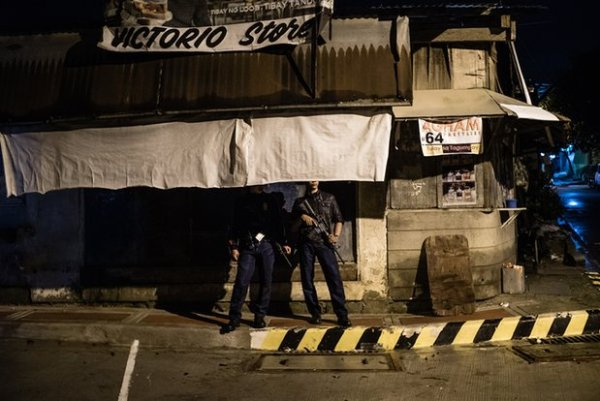 A police officer on a routine patrol in Manila. It is claimed that some police are secretly involved in extrajudicial killings. Photograph: Patrick Tombola