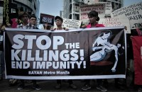 Filipino activists call for a stop to drug-related killings during a protest march in time for the observance of Holy Week. (Photo by Vincent Go)
