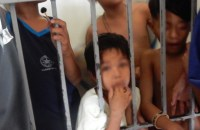 boy small in jail