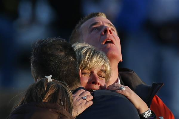 The families of victims grieve near Sandy Hook Elementary School after the mass shooting. ADREES LATIF / Reuters file