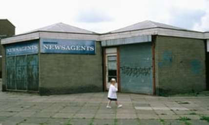 A young girl walking through a housing estate in Skelmersdale, Lancashire. Photograph: Alamy