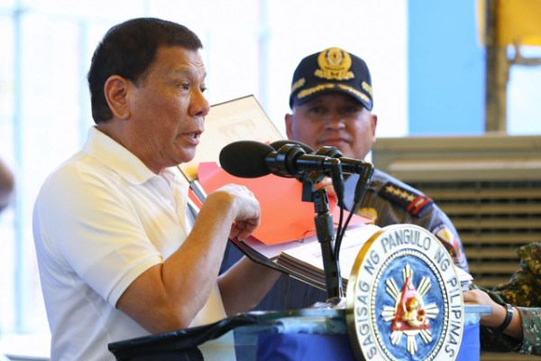 DRUG WAR. President Rodrigo Duterte shows a list of those allegedly involved in the illegal trade during his visit to the Ozamiz City Police Station on August 17, 2017. Also in the photo is Philippine National Police chief Ronald dela Rosa. Malacañang file photo