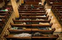 Homeless people sleep in the pews at St Boniface Catholic Church in the San Francisco Tenderloin area, as part of the Gubbio Project. Photograph: David Levene for the Guardian