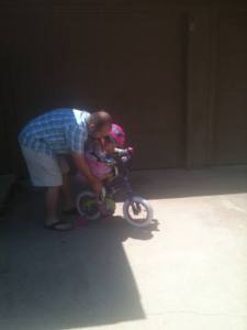 Kylie, and her dad, learning how to ride her first bike