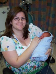 Carolyn holds her son for the first time at 4 days old