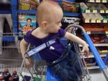 James playing it safe in the shopping cart.