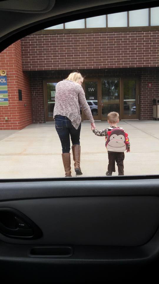 Preemie and special education teacher walking into special education preschool.