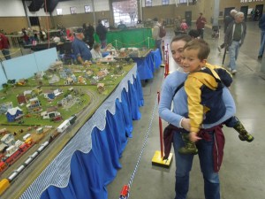 Gabriel and Miri looking at a model train layout at an expo