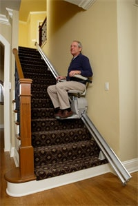 Man Riding an Elan SRE 3000 Stairlift