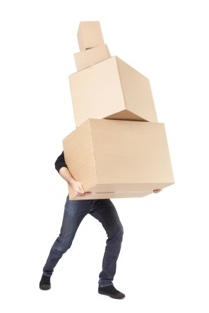 Moving day, man lifting cardboard boxes stack on white with clipping path