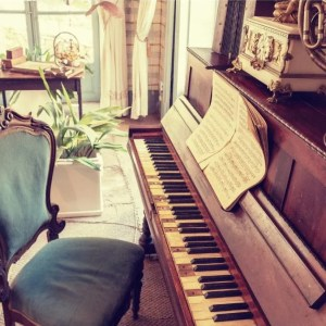 A classic in-home stand-up piano
