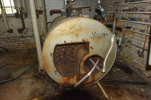 Rusty tank in wet basement