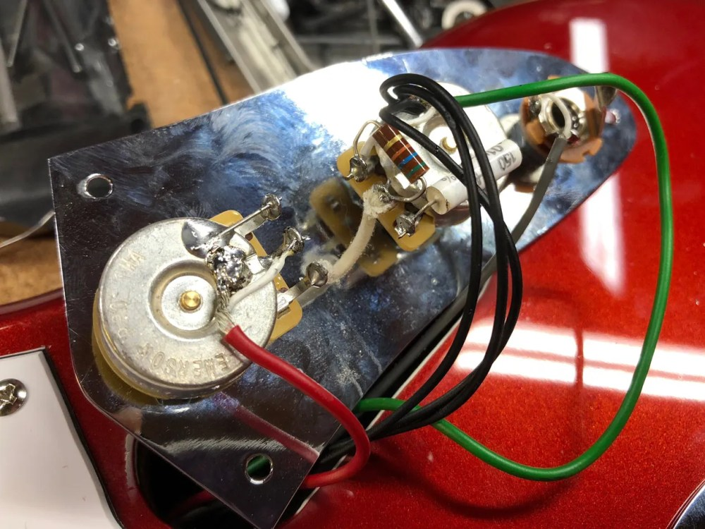 medium resolution of photo 9 the jag s lead circuit control panel after widening the pot holes and installing u s made 1m potentiometers and a mallory 01 f capacitor on the