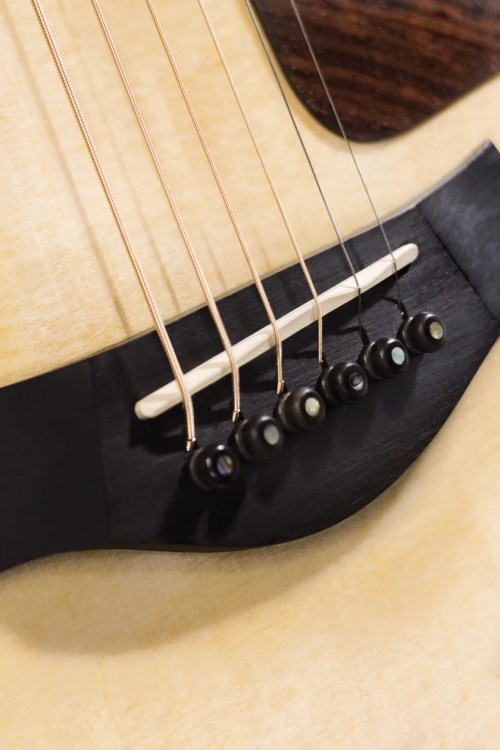 small resolution of the 2nd string s altered seating on an acoustic guitar has nothing to do with a b note but everything to do with the composition of the string itself