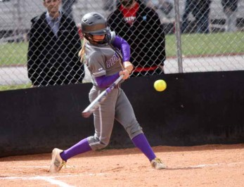 Lehi's Sydney White takes a swing in win at American Fork. (Photo by Kurt Johnson)