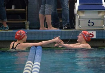 Alandra McDowell and Joelle Hess of Park City celebrate finishing 1-2 in the 200-yard individual medley. (Photo by Ari Davis)