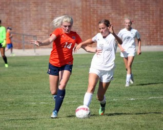 Alta's Breanna DeWaal battles Dakota Smith of Timpview for the ball during an Aug. 27, 2015 game. (Photo by Kurt Johnson)