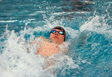 Junior Jinwon Bailar set a new state record in the 100 backstroke and was part of a record-setting relay for Park City. (Photo by Ari Davis)