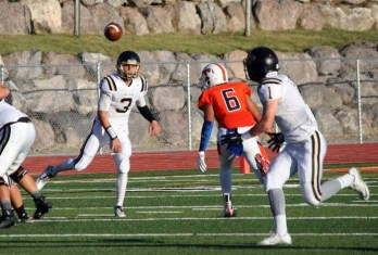 Lone Peak quarterback Talmage Gunther was a true dual threat Friday night at Timpview. (Photo by Kurt Johnson)