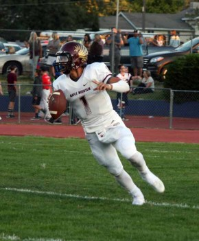 Maple Mountain quarterback Jaren Hall picks up big yards by land and by air. (Photo by Kurt Johnson)