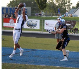 Spencer Sorensen goes up for one of Corner Canyon's four Week 1 interceptions against Pleasant Grove. (Photo by Kurt Johnson)