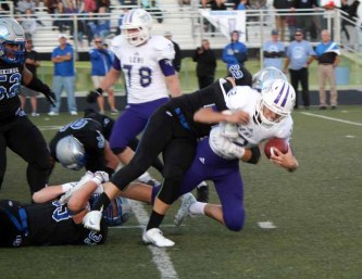 Tate Briggs and the Pleasant Grove defense made it a long night for Lehi. (Photo by Kurt Johnson)