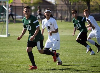 The defensive effort of Eric Garcia (9) was key in Mountain View's win over Provo. (Photo by Kurt Johnson)