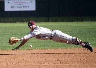 Second baseman Keenan Kelshaw dives to keep a ground ball on the infield for Lone Peak. (Photo by Kurt Johnson