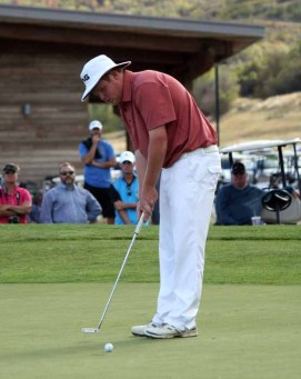 Park City's Mitchell Schow putts out to win his third straight state title. (Photo by Kurt Johnson)