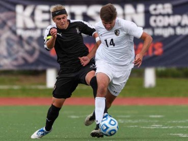 Junior midfielder Marshall Johnson (left) works to gain possession in a state semifinal contest for Viewmont boys soccer. (Photo by Dave Argyle, dbaphotography.com)
