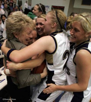 Skyline coach Deb Bennett gets swamped by her team after defeating Mt. View for the Girls 5A Championship Saturday February 25, 2006. (Photo by Scott G. Winterton, DeseretNews. com)