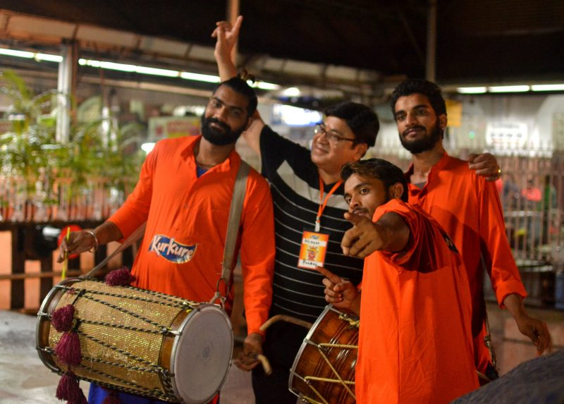 One of the winners posing with the band