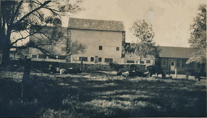 black and white photo shows a barn in good condition