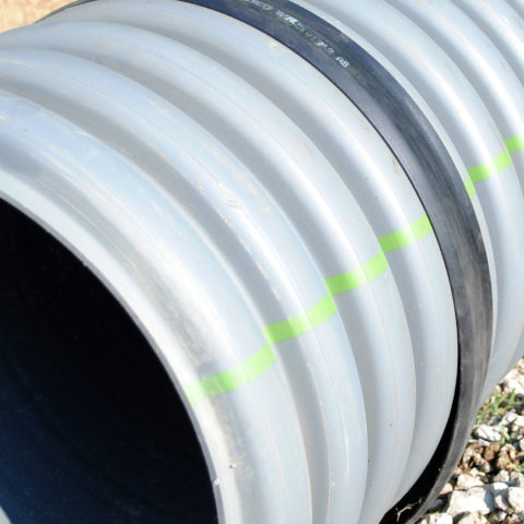 ADS pipe adapter for pipe connecting to concrete manholes