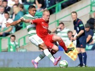 Emilio Izaguirre clatters Nicky Low when the two teams met earlier this season