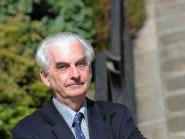 "Proffesor Hugh Pennington has said it is ""vital"" the SNP press ahead with the trauma centre plans"