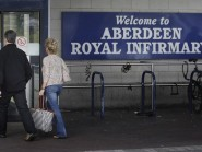 A football fan was taken to Aberdeen Royal Infirmary after collapsing at the ground