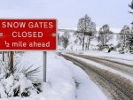 Roads closed as snow falls