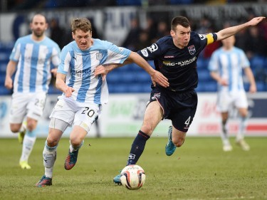 James McAlister and Paul Quinn fight for the ball