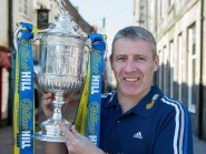 Barry Wilson gets his hands on the Scottish Cup