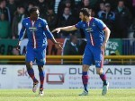 Draper celebrates with Ofere in their last encounter with Celtic