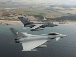 RAF 1 (F) Squadron Typhoon formating with XV (R) Squadron Tornado GR4 flying over RAF Lossiemouth.