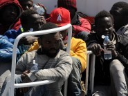 Surviving migrants arrive at Palermo's harbour, Italy, after being rescued at sea