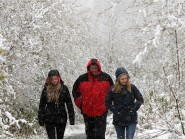 A family braves the snow to take a walk in the Highlands yesterday